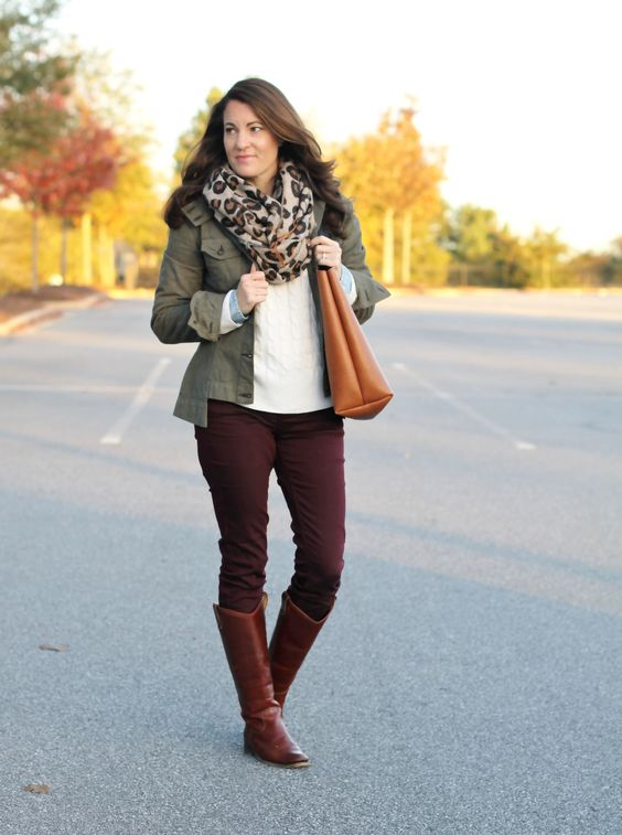 Cream cable knit sweater, chambray shirt,  utility jacket,  burgundy pants,  cognac boots and tote, leopard scarf.