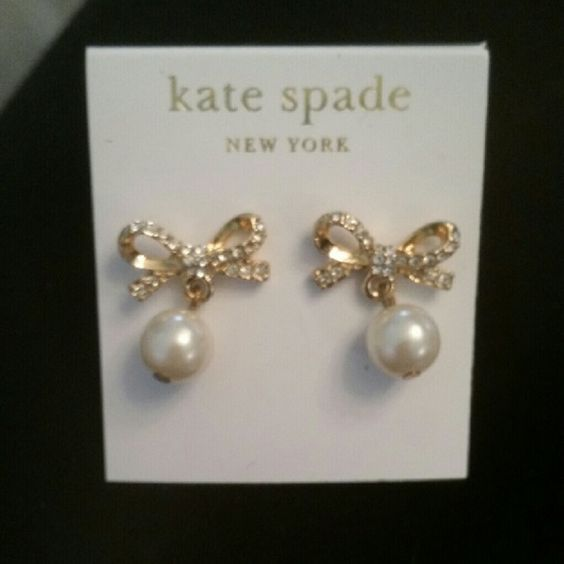 Kate spade bow and pearl dangle earrings Brand new never worn Kate spade gold plated rhinestone bow earrings with pearl dangles. Gorgeous! kate spade Jewelry Earrings