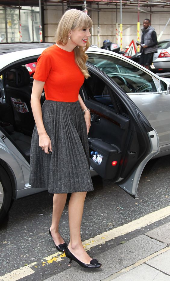 Taylor Swift's Red back button dress with grey pleated skirt in London.  Outfit details: http://wwtaylorw.com/1619/