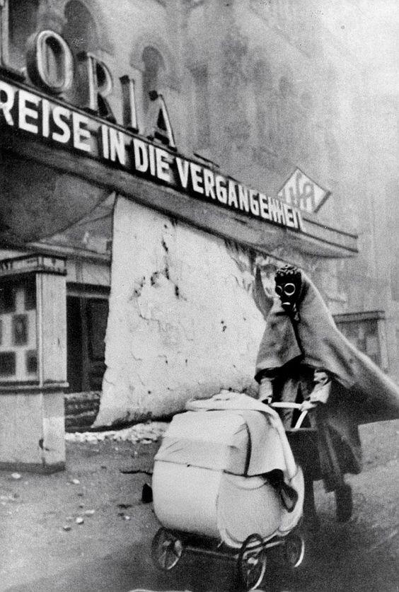 Frau mit Gasmaske, Kurfürstendamm, Berlin, 1945, by Wolf Strache