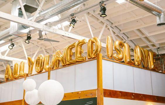 gold balloons words all you need is love modern lighting wedding reception decor decoration | Jen + Kat | Los Angeles Stylish Same Sex Wedding | Jenn Emerling Weddings