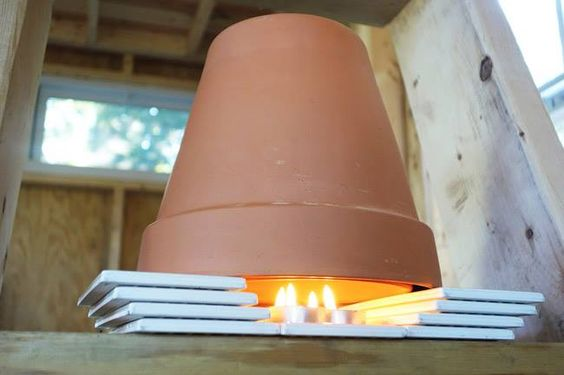 A DIY Tiny House Heater using terra cotta plant pot and tea light candles. If you click the image, you'll be delighted to see youtube vids to show you it all.