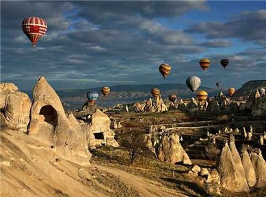 This is an annual balloon regatta held in the popular tourist destination of Cappodacia, Turkey, well known for its cone-shaped formations, many of which have been used for centuries as houses, shops and worship centers for residents.