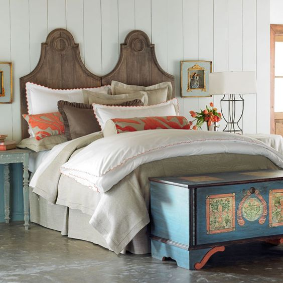 Guest room:  Light wood headboards (DIY?). Gold curtains. Light greige paint.  Aqua sheets. Flax linen bedskirts. Coral, light blue and flax accent pillow.  Brass lamp with white lampshade. White duvets and std shams. Teal dresser (painted like this)