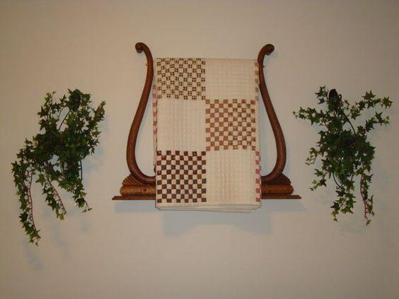 Quilt hanger made from an old dresser.