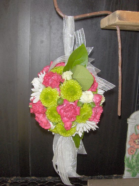 Flower girl pomander with mini carns, kermit mums and daisies.