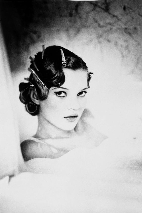 Kate Moss by Ellen Von Unwerth this has a focus in the play of darkness draped…