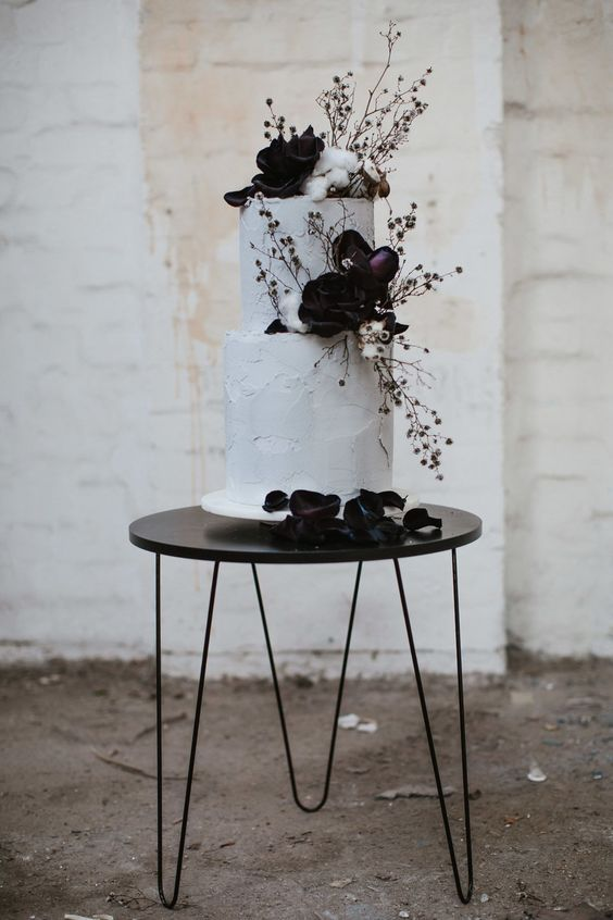 modern marble wedding cake with black flowers