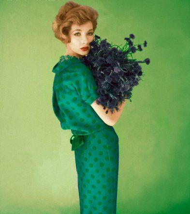 An emerald green polka dot dress in a 1958 issue of Vogue