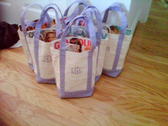 I monogrammed each bag for my bridesmaids and stuffed them with magazines, make up, koozies, body lotion, and cocktail mix