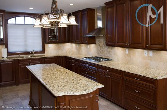 Cabinets don't get much darker than this and the colonial gold granite gives it a little bit of light. Pair it with a light backsplash and you've got a great look that's just the right amount of deep and dark.