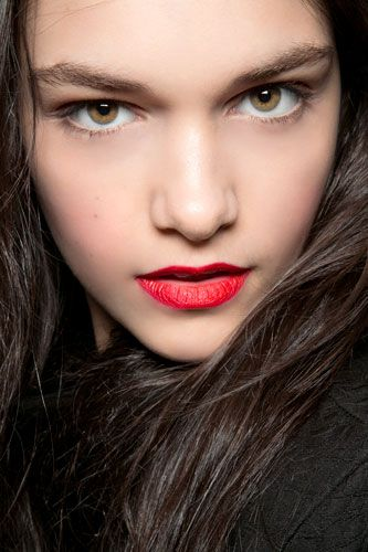 Gorgeous eyebrows and bright red lips. Love it!