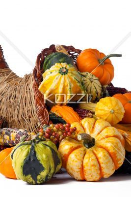 vegetables - Vegetables spilling out of a wicker cornucopia.