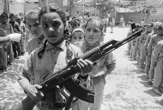 1970, Beirut, Lebanon --- Young girl holding a machine gun, with other children in training as commandos, at a Palestinian refugee camp which gave strong support to Al Fatah, the pre-PLO (Palestine Liberation Organization) group of which Yassir Arafat was the leade