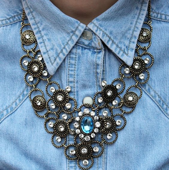 Chunky necklace with a collared shirt
