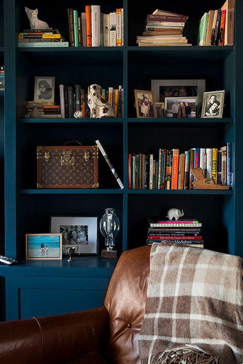 dark painted bookshelves