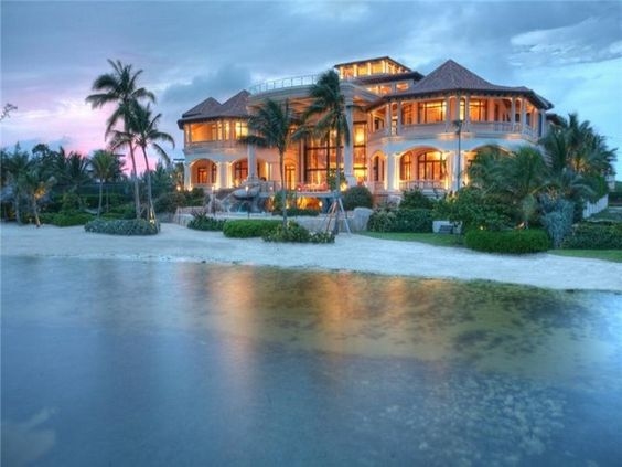 """Located on Grand Cayman, this jaw-dropping vacation home is 48,000 square feet of over the top opulence. Click the image to see photos of the interior! Worth every """"penn-ty"""" of that 60-million-dollar price tag."""