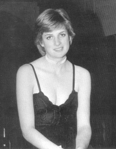 Amidst the splendour of the stately Althorp House Diana added her own touch of glamour with what became one of her trademarks - pearls.  Diana poses for her father in the hallway of Althorp House before a ball in 1980.