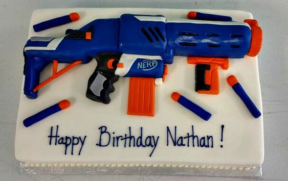 White velvet cake with choclate buttercream. Gun is RKT. Fondant decor