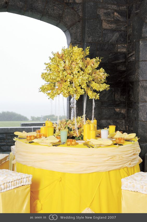 Maize and lemon-colored gauze cuffed with pleated Cumberland, finished with a crystal pillar-style arrangement topped with yellow vanda and cymbidium orchids. @grace_ormonde @wedding_style
