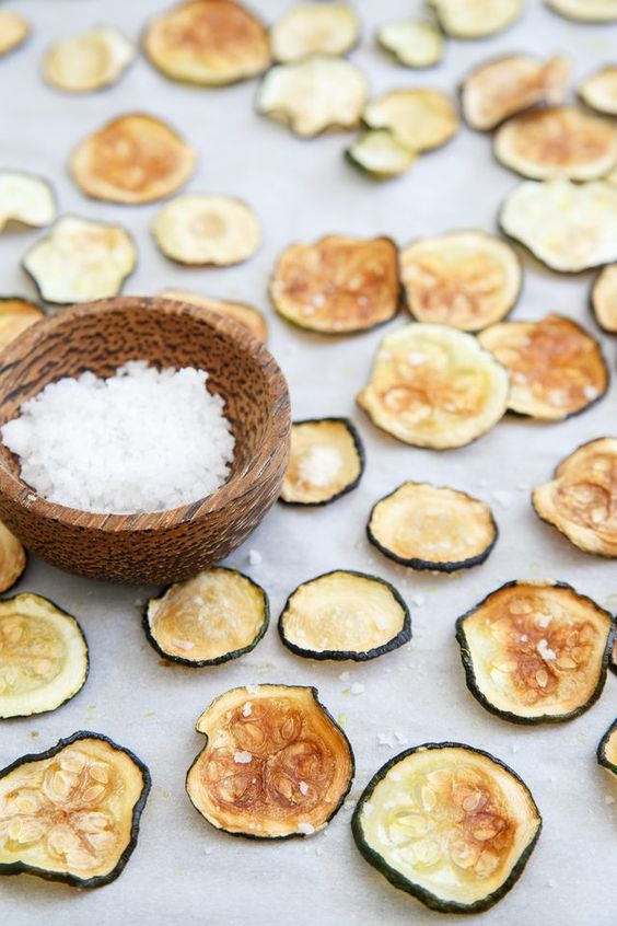 Learn how to make crispy zucchini chips in the oven without the need for a dehydrator. Sprinkled with sea salt, they're a delicious and healthy snack!