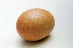A very fresh egg, placed in water, will lie on the bottom. A week-old egg will lie on the bottom but bob slightly. An egg that is around three weeks old will balance on its small end, with the large end up. And a bad egg will float.