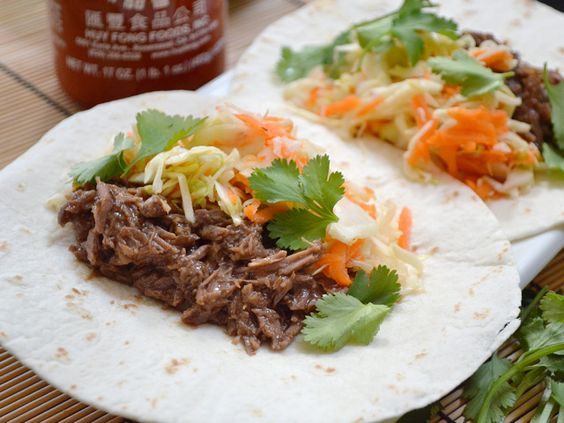 These super easy Asian inspired Hoisin Beef Tacos are stuffed with slow cooked shredded beef, hoisin sauce, and a simple sweet