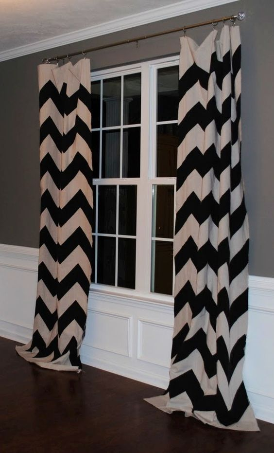 Black And White Chevron Curtains Against Grey Wall