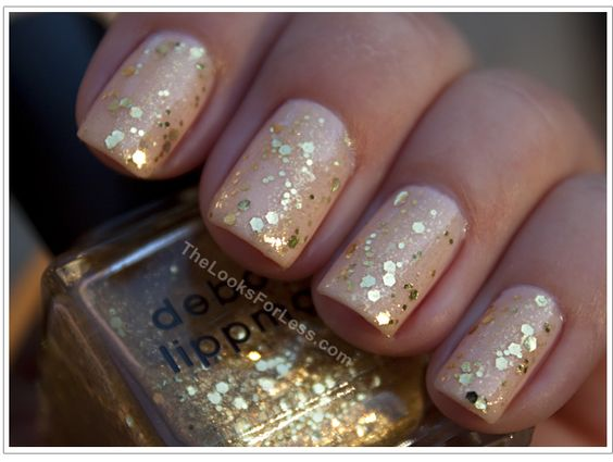 Blush with gold glitter nails