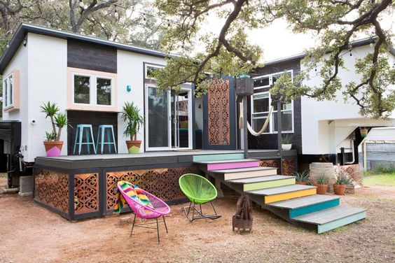 Not 'EVERYTHING' is bigger in Texas. This tiny house is 370 square feet. Kim Lewis Designs painted the stair risers leading up to the trailer to create a whimsical, bohemian vibe!