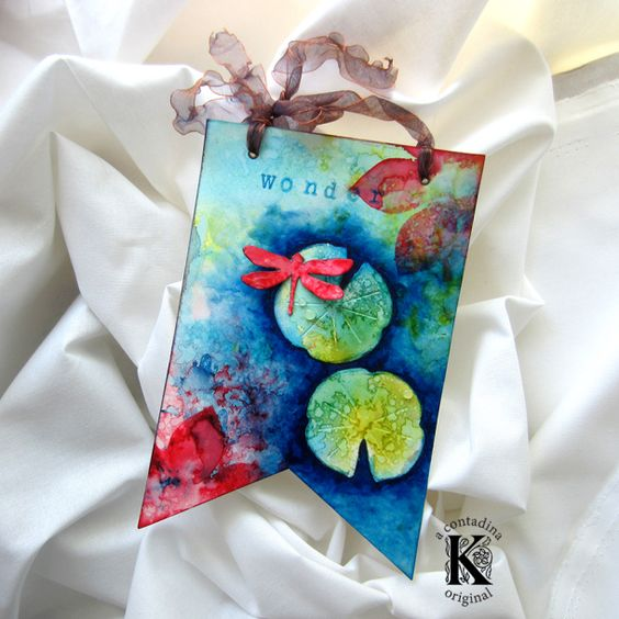 Reminiscent of a cool lily pond on a hot day, this mixed media banner by Vivian Keh made with Vintaj & Brenda Walton dies is just stunning!