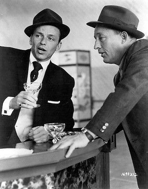 "Frank Sinatra and Bing Crosby sipping champagne and singing in ""High Society."""