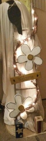 "** FOR SALE!! **  handmade indoor/outdoor ""welcome"" decoration.  the ladder with daisies, a crow, and lights is one piece. the american flag blocks are seperate pieces. will sell seperately or all together."