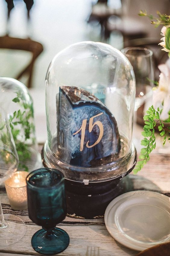 Great idea for table numbers! Agate slice table numbers under a cloche