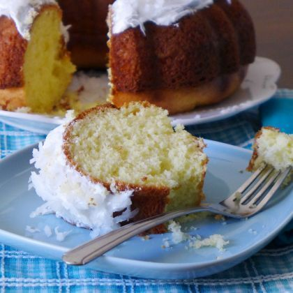 Stitch's Favorite Coconut Cake 1 (15.25 oz) box white cake mix 1 cup coconut milk 1/2 cup vegetable oil 3 eggs 6 oz. whipped topping 3/4 cup sweetened  shredded coconut.