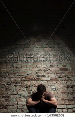 Sad Man Sitting Alone Against Brick Wall. Stock Photo 143592532 : Shutterstock