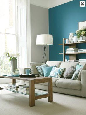 Beautiful teal accent wall for your living room get the look with dunn edwards aegean sea for Teal accent wall living room