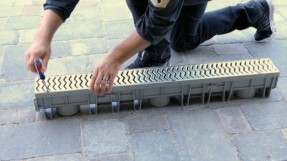 Channel Drain Maintenance How To Remove The Grate Video Video Driveway Drain Driveway Landscaping Landscape Drainage