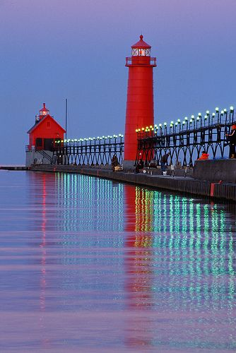 vertical reflection. Lighthouse and pier at Grand Haven, MI