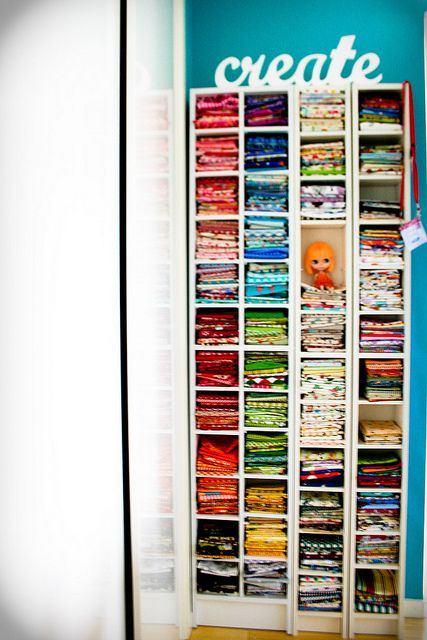CD racks for folded fabric!!  Love this idea!