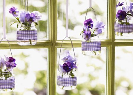Pretty hanging glass vases out of baby food jars-- hang cup hooks in the front windows and do this whenever new flowers are blooming in the kitchen garden :)