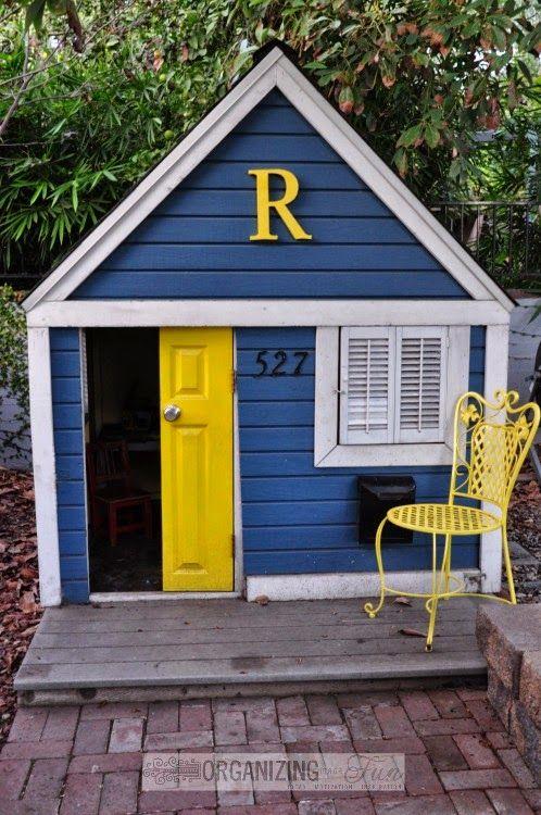Adorabe kids' playhouse painted blue and yellow with white trim :: OrganizingMadeFun.com