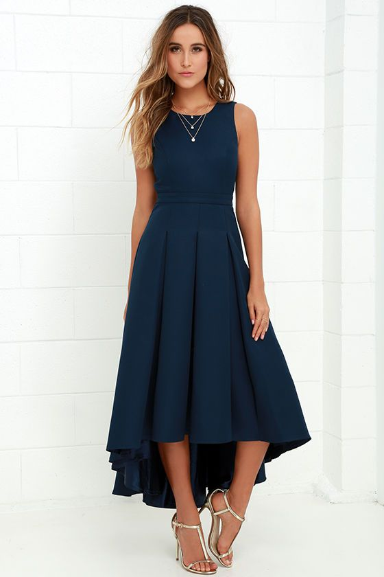When you pass by in the Paso Doble Take Navy Blue High-Low Dress, heads will always turn! Take a twirl in this well-constructed sleeveless woven stunner, with princess seams, and open back with top button. Banded waist leads into a pleated high-low skirt. Hidden back zipper with clasp.