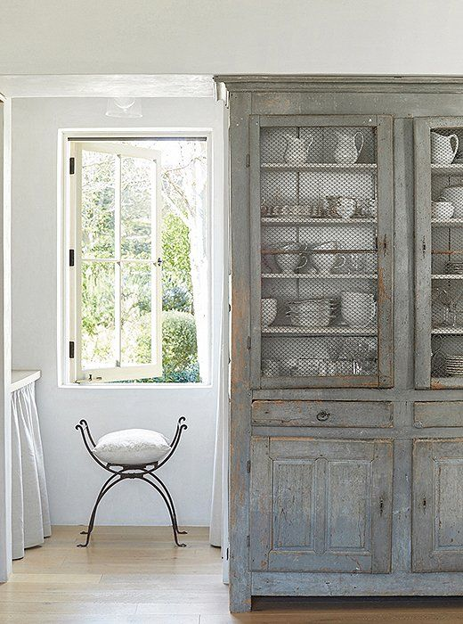"""French Country decor inspiration from the kitchen at Patina Farm. Brooke uses an antique French cabinet for silverware and dishes. """"I tend to stick with white."""" she says. #swedishantique #countrydecor #shabbychic"""