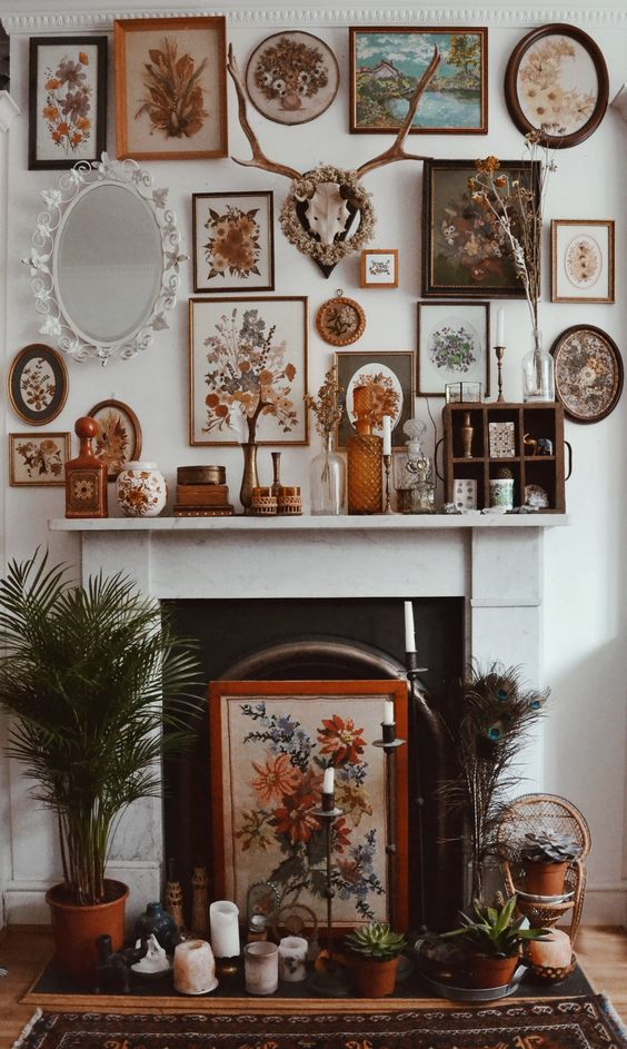 Eclectic frames make for a totally beautiful fireplace. Hippy homes make us so happy.
