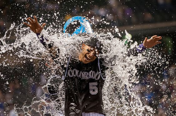 Carlos Gonzalez #5 of the Colorado Rockies is drenched by a teammate after hitting a walk-off 2-run home run to put the Rockies ahead of the Dodgers 8-6 at Coors Field in Denver, Colorado