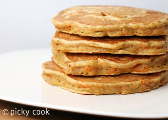 carrot cake pancakes with cinnamon honey butter.
