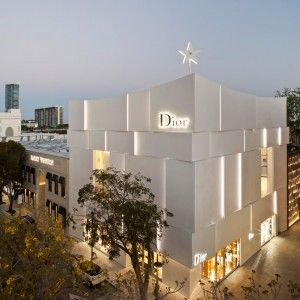 Miami+Dior+boutique+by+Barbarito+Bancel+is+sheathed+in+curved+white+concrete+panels