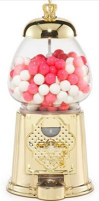 juicy couture gumball machine with pink gumballs.