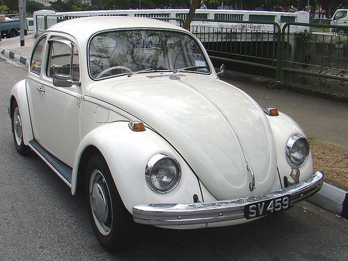 white VW bug - Kat's car, bought used over the summer of 2013 with money saved working at The Alcove